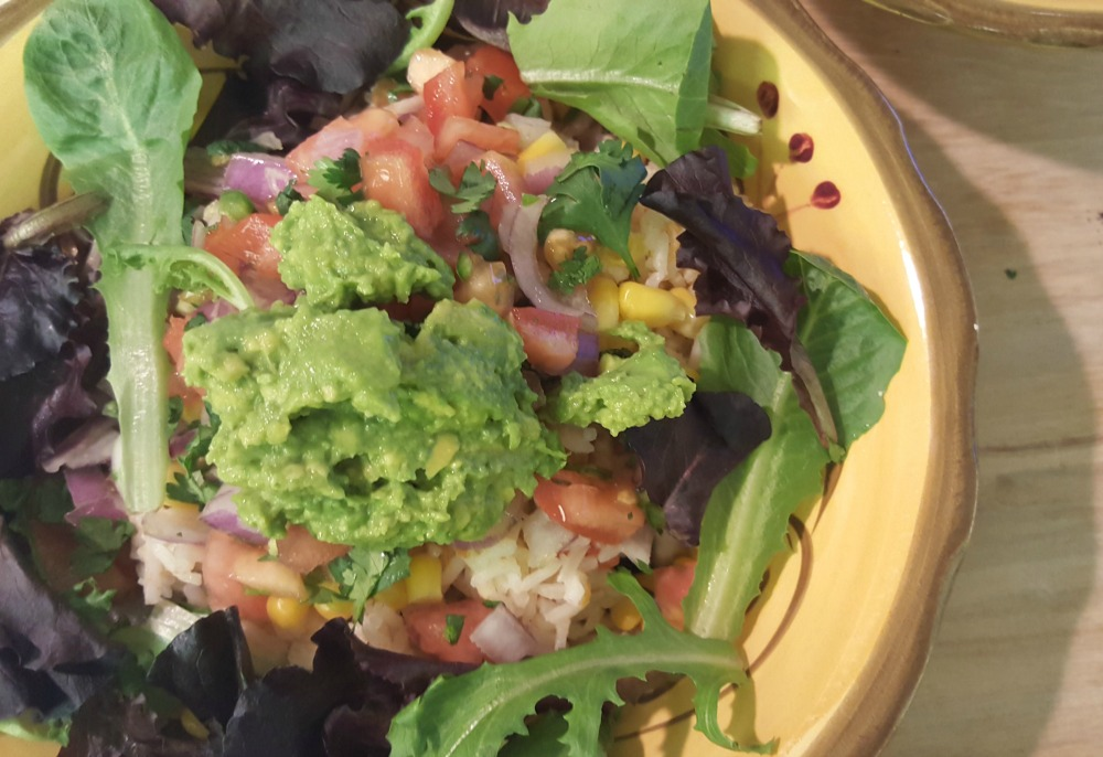 This truly is the ultimate spicy black bean burrito bowl. It is vegan and delicious, plus it's quick and easy to make! A great vegan recipe.