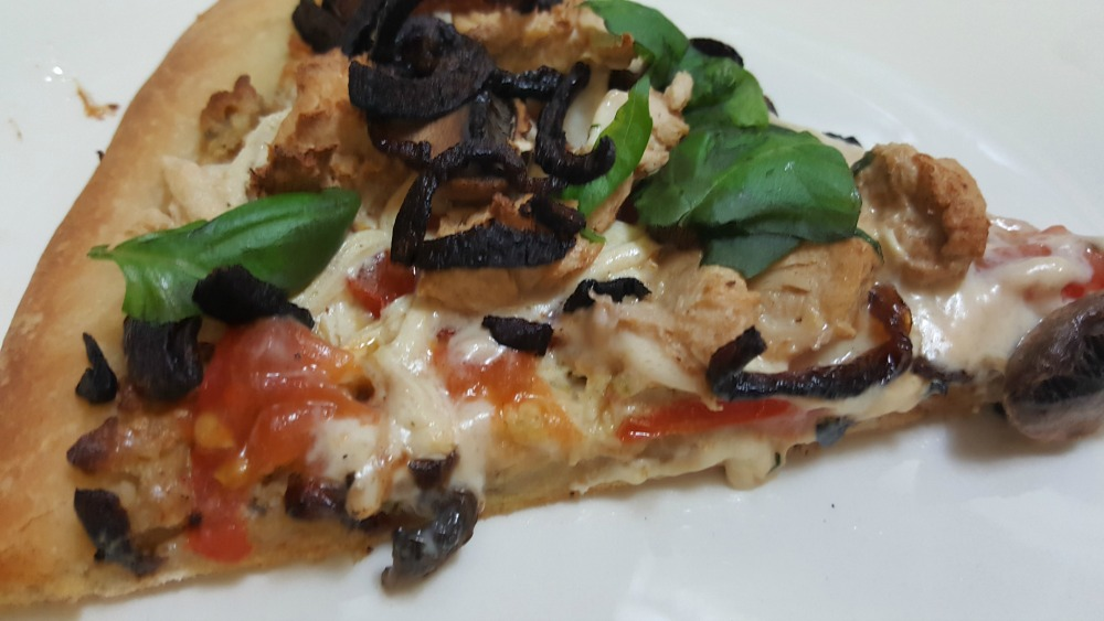 Try a new spin on pizza! This vegan chicken pizza is made with cashew cheese plus mushrooms, caramelized onions, and basil.